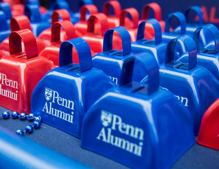 Rows of red and blue Penn Alumni bells
