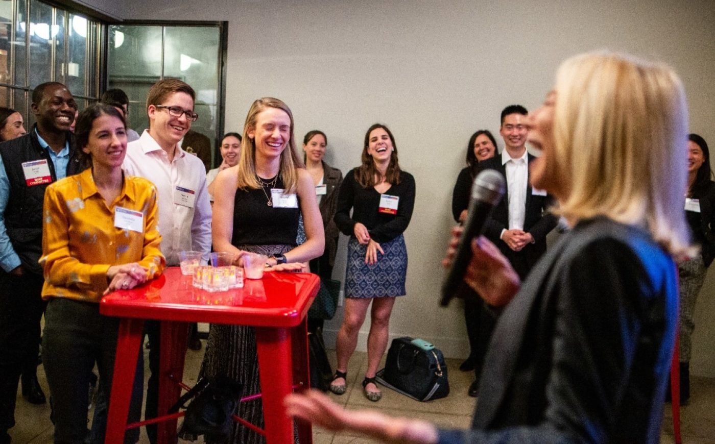 Young Alumni laughing with President Amy Gutmann at NYC event