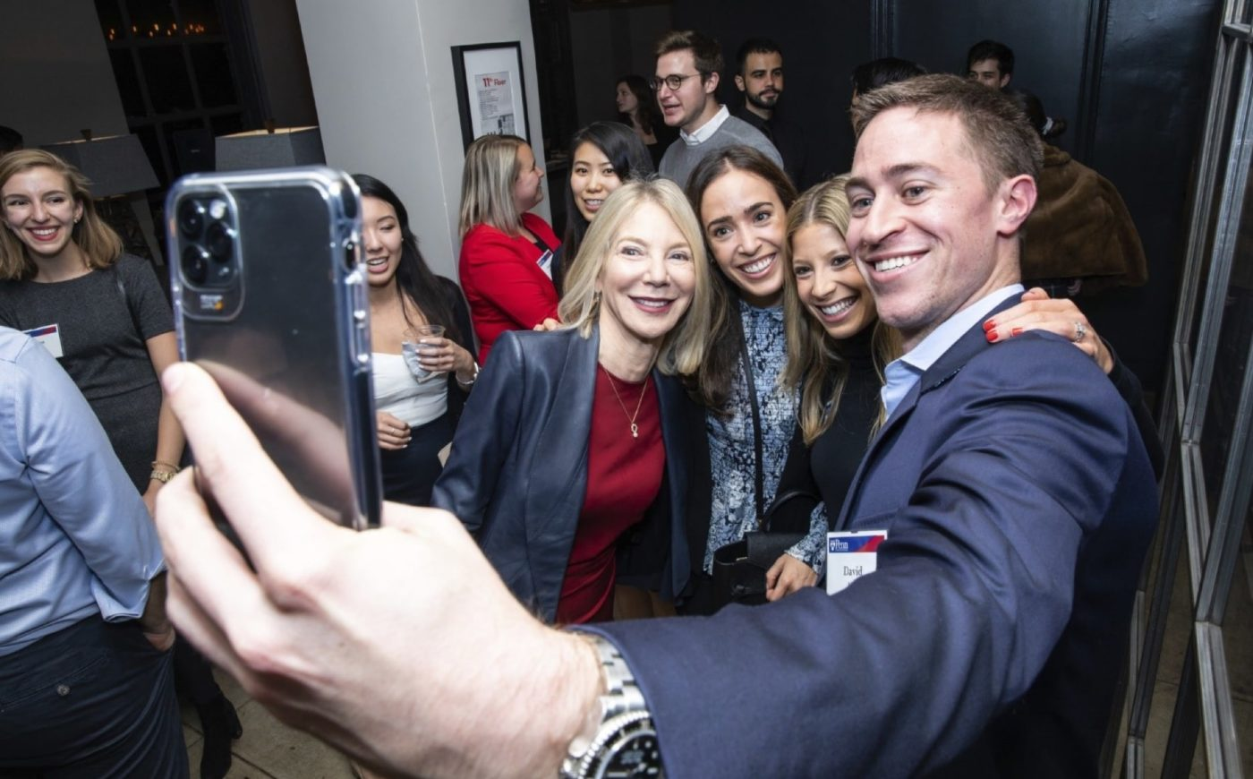 Young Alumni taking a selfie with President Amy Gutmann at NYC event